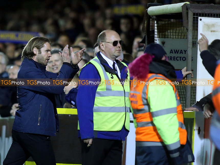 MK Dons Manager, Robbie Neilson, applauds the AFC Wimbledon fans as he heads to the dressing room after the match during AFC Wimbledon vs MK Dons, Sky Bet EFL League 1 Football at the Cherry Red Records Stadium on 14th March 2017