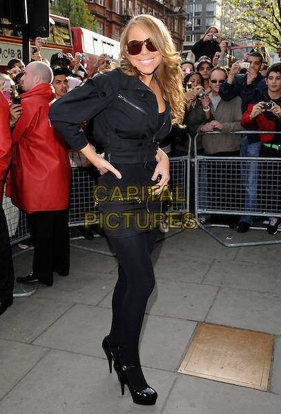 "MARIAH CAREY.Arriving to a CD signing for her new single ""Touch My Body"" from latest album ""E=MC2"", Selfridges, Oxford Street, London, England, April 01 2008..full length sunglasses shades black zip-up top jacket gold zips zippers mini skirt tights platform patent shoes mary janes heels hand band aid plaster butterfly ring on hip.CAP/CAN.©Can Nguyen/Capital Pictures"