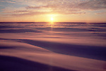 Arctic Alaska, the North Slope, Prudhoe Bay, Spring sunshine over wind-sculpted snow..