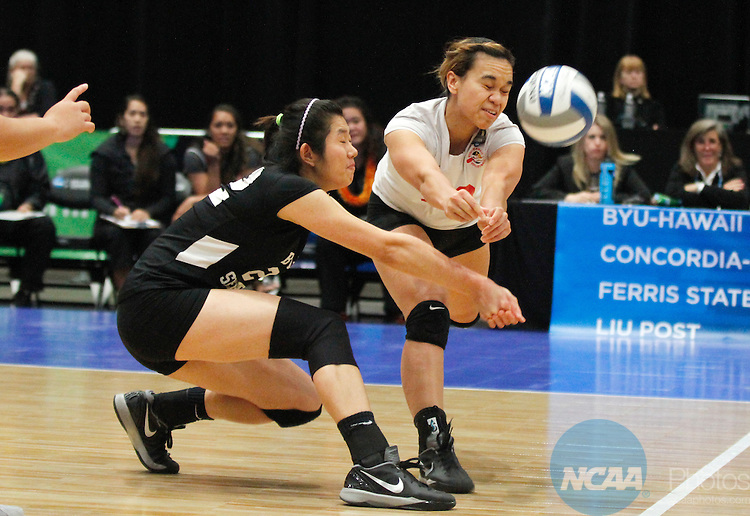 14 DEC 2013: Brydgette Tatupu-Leopoldo (33) and teammate Shih Ting (Stella) Chen (22) converge in an attempt to dig the ball during the Division II Women's Volleyball Championship game held at the U.S. Cellular Center in Cedar Rapids, IA.  Concordia-St. Paul won over BYU-Hawaii in 3 straight sets to claim the championship title. <br /> Conrad Schmidt/NCAA Photos