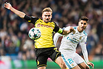 Borussia Dortmund Defender Marcel Schmelzer (L) in action against Marco Asensio of Real Madrid (R) during the Europe Champions League 2017-18 match between Real Madrid and Borussia Dortmund at Santiago Bernabeu Stadium on 06 December 2017 in Madrid Spain. Photo by Diego Gonzalez / Power Sport Images