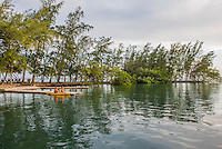 Honduras, Roatan Island, Fantasy Island Resort, Caribbean. Man and woman with kayak on the dock.