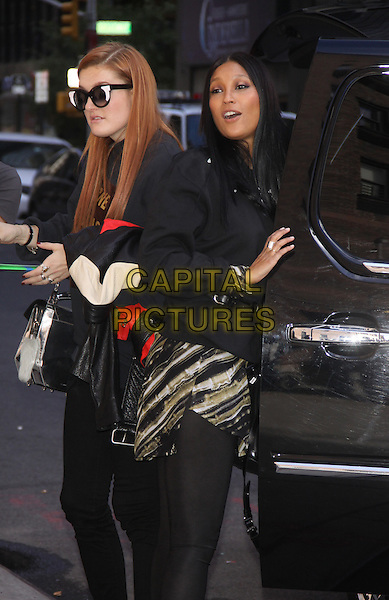 Caroline Hjelt and Aino Jawo of Icona POP at the Ed Sullivan Theater for an appearance on Late Show with David Letterman in New York City, USA.<br /> September 25th, 2013 <br /> full length black top skirt dress car mouth open sunglasses shades <br /> CAP/MPC/RW<br /> &copy;RW/ MediaPunch/Capital Pictures