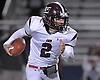 Ryan Aughavin #2, North Shore quarterback, runs the ball on a keep during the Nassau County varsity football Conference IV semifinals against Carle Place-Wheatley at Hofstra University on Saturday, Nov. 12, 2016.