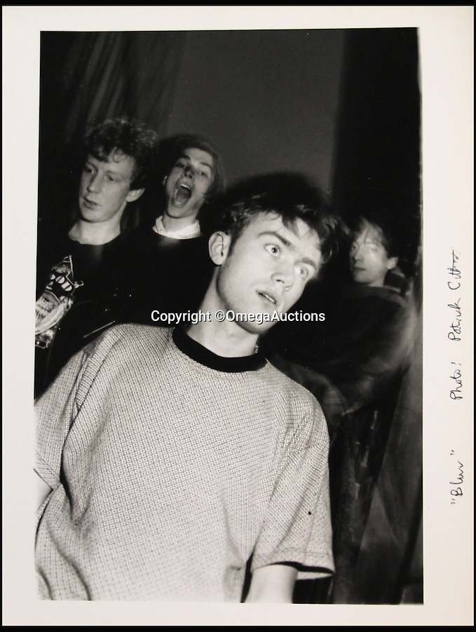 BNPS.co.uk (01202 558833)<br /> Pic: OmegaAuctions/BNPS<br /> <br /> Before they were famous...fledgling Britpop stars photographed in 1989.<br /> <br /> Rare promotional photographs of the rock band Blur taken long before they became household names have been unearthed.<br /> <br /> The collection of black and white snaps which date from 1989 have remained unpublished and hidden away.<br /> <br /> The images were shot before they were signed up by record label Food in 1990. <br /> <br /> The photographs have been in the possession of a former BBC Radio London producer since they were sent into the station ahead of an appearance by Blur on a music show for up and coming bands in 1989.