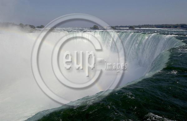 Niagara Falls, Ontario, Canada - 01 August 2006---The Niagara River falling horseshoe-wise / Horseshoe Falls with rainbow---nature---Photo: Horst Wagner / eup-images