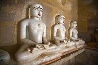 Hand carved WHITE MARBLE statues of MAHAVIRA in a JAIN TEMPLE inside JAISALMER FORT - RAJASTHAN, INDIA