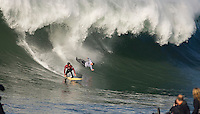 Ryan Seelbach, left, looks up as a diving Ross Clarke-Jones, right, wipes out on a wave during the 2008 Mavericks Surf Contest in Half Moon Bay, Calif., Saturday, January 12, 2008.