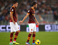 Calcio, Serie A: Roma vs ChievoVerona. Roma, stadio Olimpico, 31 ottobre 2013.<br /> AS Roma midfielders Kevin Strootman, of the Netherlands, and Miralem Pjanic, of Bosnia, right, prepare for a free kick during the Italian Serie A football match between AS Roma and ChievoVerona at Rome's Olympic stadium, 31 October 2013.<br /> UPDATE IMAGES PRESS/Riccardo De Luca