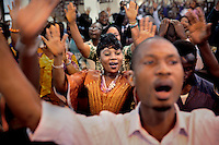 Mary Koroma, 30, participating in a Sunday service at the Winners' Chapel International, a Christian church in central Freetown. The Sierra Leonean authorities have demanded that crowds of people should not gather together and have given strong advice that people keep a one meter distance from strangers. But those rules seem not to include religious services.