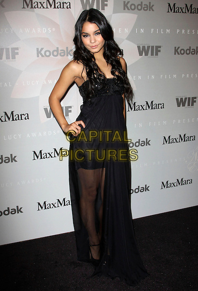 VANESSA HUDGENS.2010 Crystal + Lucy Awards: A New Era_Arrivals held at The Hyatt Century Plaza Hotel, Century City, CA, USA..June 1st, 2010 .full length dress sheer maxi black sequins sequined mini hand on hip.CAP/ADM/KB.©Kevan Brooks/AdMedia/Capital Pictures.