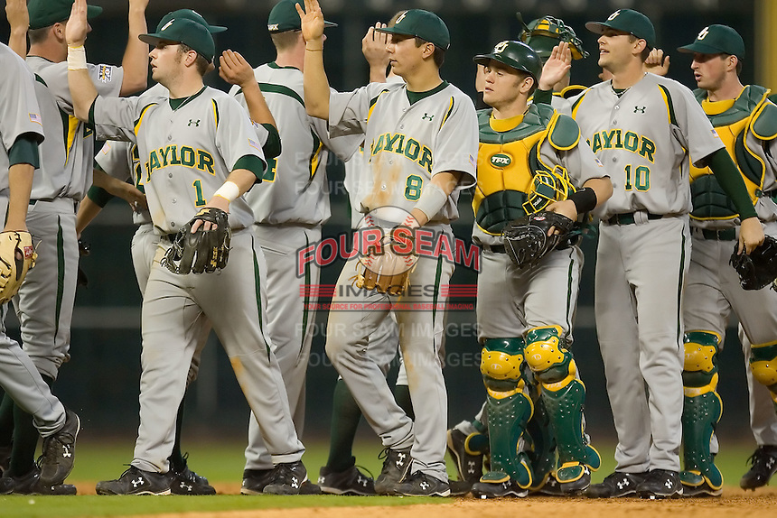 The Baylor Bears celebrate their win over the UCLA Bruins in the 2009 Houston College Classic at Minute Maid Park February 28, 2009 in Houston, TX.  The Bears defeated the Bruins 5-1. (Photo by Brian Westerholt / Four Seam Images)
