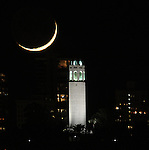 The 6-percent crescent moon set behind Coit Tower as seen from Treasure Island, San Francisco, CA