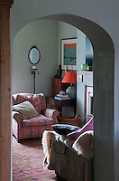 View through the archway from the kitchen into the comfortable living room