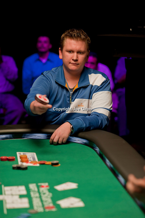 """Ben Lamb throws his 'bounty"""" chip in the direction of Kevin MacPhee, who busted him."""