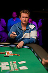 "Ben Lamb throws his 'bounty"" chip in the direction of Kevin MacPhee, who busted him."