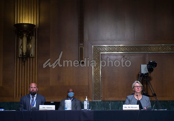 """Judith A. McMeekin, Pharm.D., Associate Commissioner for Regulatory Affairs, Office of Regulatory Affairs, Food and Drug Administration and Associate Commissioner for Global Policy and Strategy, Food and Drug Administration, Mark Abdoo (L) look on during a United States Senate Finance Committee hearing on """"COVID-19 and Beyond: Oversight of the FDA's Foreign Drug Manufacturing Inspection Process"""" at the US Capitol in Washington, DC on June 2, 2020.<br /> Credit: Andrew Caballero-Reynolds / Pool via CNP/AdMedia"""