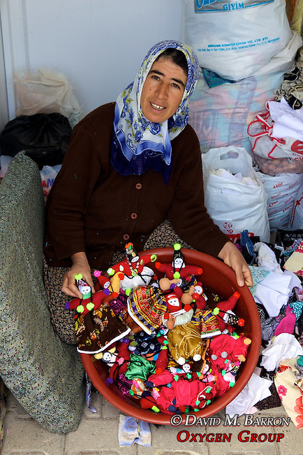 Woman Selling Dolls