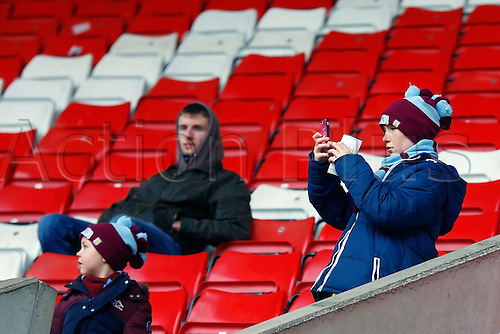 27.02.2016. Britannia Stadium, Stoke, England. Barclays Premier League. Stoke City versus Aston Villa. Young Villa supporter takaes a picture inside the ground