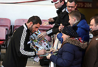Pictured: Angel Rangel signs autographs for fans. 01 February 2014<br /> Re: Barclay's Premier League, West Ham United v Swansea City FC at Boleyn Ground, London.
