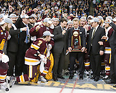 Jack Connolly (Duluth - 12), Cody Danberg (Duluth - 20), Bill Watson (Duluth - Volunteer Assistant Coach), Kyle Schmidt (Duluth - 7), Kenny Reiter (Duluth - 35), ?, Clay Matvick, Mike Connolly (Duluth - 22), Justin Faulk (Duluth - 25), Joe Basaraba (Duluth - 18), Scott Sandelin (Duluth - Head Coach), ? - The University of Minnesota-Duluth Bulldogs celebrated their 2011 D1 National Championship win on Saturday, April 9, 2011, at the Xcel Energy Center in St. Paul, Minnesota.