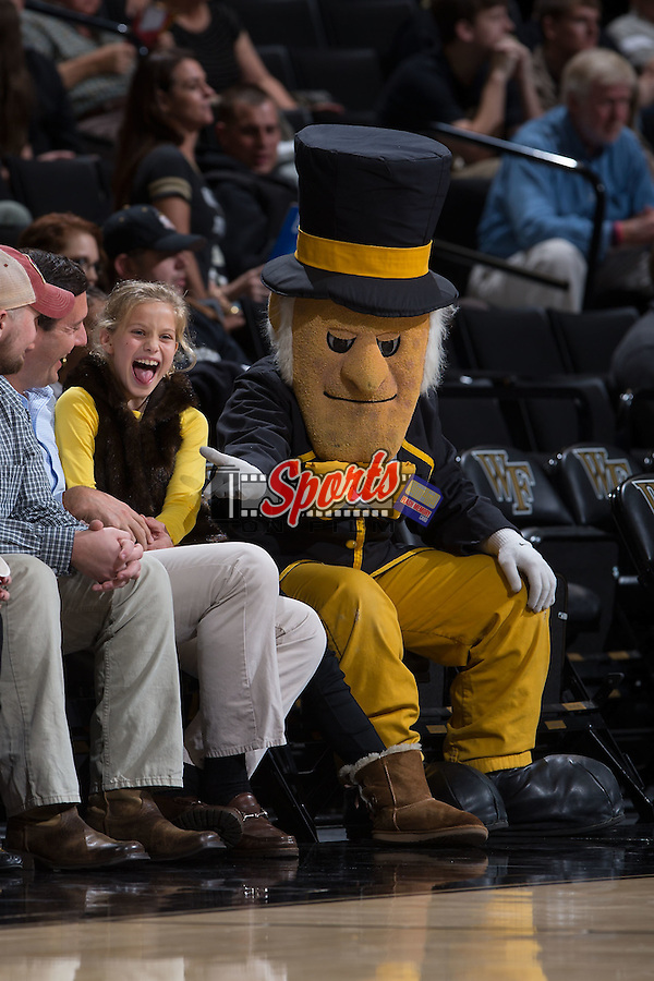 The Wake Forest Demon Deacons mascot has fun with a young fan sitting court side during the game against the UNCG Spartans at the LJVM Coliseum on December 15, 2015 in Winston-Salem, North Carolina.  The Demon Deacons defeated the Spartans 81-71.  (Brian Westerholt/Sports On Film)