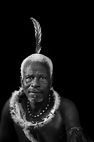 Portrait of man wearing traditional dress looking at camera, Eswatini, Africa