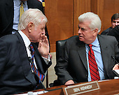 """Washington, D.C. - January 8, 2009 -- United States Senator Edward M. """"Ted"""" Kennedy (Democrat of Massachusetts), left, shares a thought with United States Senator Christopher Dodd (Democrat of Connecticut) prior to hearing the testimony of former United States Senator Tom Daschle (Democrat of South Dakota) at the United States Senate Committee on Health, Labor, Education, and Pensions on Daschle's nomination to be Secretary of Health and Human Services in Washington, D.C. on Thursday, January 8, 2009..Credit: Ron Sachs / CNP"""