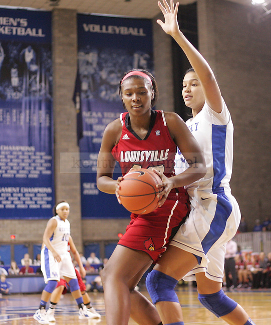 UK freshman center Azia Bishop guards Cierra Warren of Louisville during the first half of the UK Women's basketball game against Louisville on 12/4/11 in Lexington, Ky. Photo by Quianna Lige   Staff