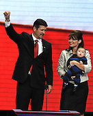 St. Paul, MN - September 3, 2008 -- Governor Sarah Palin of Alaska, center, holds baby Trig, right, as her husband, Todd, left, celebrates after she accepted the Republican nomination as Vice President of the United States on day 3 of the 2008 Republican National Convention at the Xcel Energy Center in Saint Paul, Minnesota on Wednesday, September 3, 2008.Credit: Ron Sachs / CNP.(RESTRICTION: NO New York or New Jersey Newspapers or newspapers within a 75 mile radius of New York City)