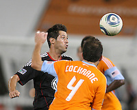 Branko Boskovic #27 of D.C. United heads the ball away from Ryan Cochrane #4 of the Houston Dynamo during an MLS match at RFK Stadium in Washington D.C. on September  25 2010. Houston won 3-1.