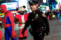 A New York Police Officer patrols Times Square decorated for Christmas holidays in New York, 12/9/2015 Photo by VIEWpress