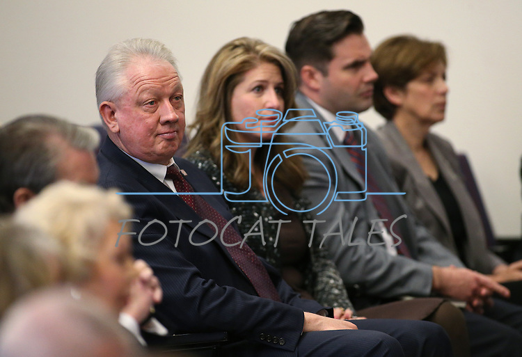 Western Nevada College President Chet Burton listens to the opening ceremony of the Always Lost: A Meditation on War exhibit at the Legislative Building in Carson City, Nev., on Monday, April 6, 2015. <br />