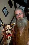 Briton Jake Davies poses for a photo with one of his Iwami-Kagura masks -- the female demon Hanya from Iwami-Kagura dance -- at his home in Sakurae Village, Shimane Prefecture, Japan on 28 June 2011..Photographer: Robert Gilhooly