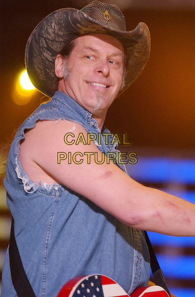 TED NUGENT.2007 CMA Music Festival held at LP Field, Nashville, Tennessee, USA..June 8th, 2007.half length stage concert live gig performance music blue sleeveless shirt hat .CAP/ADM/GS.©George Shepherd/AdMedia/Capital Pictures