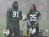 Sheldon Richardson #91 New York Jets defensive end, left, and Calvin Pryor #25 strong safety have a chat during practice at the Atlantic Health Jets Training Jets Training Center in Florham Park, NJ on Wednesday, Dec. 30, 2015.