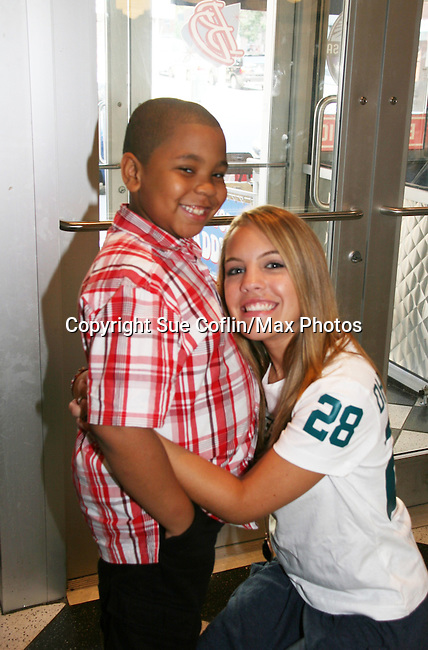 One Life To Live's Kristen Alderson poses with Siara at her annual Fan Gathering on August 16, 2009 at Big Daddy's Diner, New York City, New York. Eddie Alderson and mom Kathy were there also. Great time. (Photo by Sue Coflin/Max Photos)