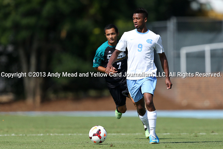 02 September 2013: North Carolina's Jordan McCrary (9) and Coastal Carolina's Ricky Garbanzo (7). The University of North Carolina Tar Heels hosted the Coastal Carolina University Chanticleers at Fetzer Field in Chapel Hill, NC in a 2013 NCAA Division I Men's Soccer match. UNC won the game 4-0.