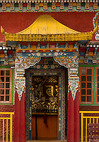 Art in a Buddhist monastery, Sikkim, India - carved and painted colorful entrance