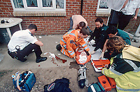 HEMS, helicopter emergency medical service, paramedics and doctors along with paramedic ambulance crews and police officers attend an incident where a child fell three stories onto a concrete patio. This image may only be used to portray the subject in a positive manner..©shoutpictures.com..john@shoutpictures.com