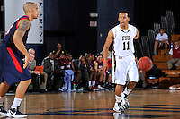 25 February 2012:  FIU guard Phil Taylor (11) handles the ball in the second half as the FIU Golden Panthers defeated the University of South Alabama Jaguars, 81-74, at the U.S. Century Bank Arena in Miami, Florida.