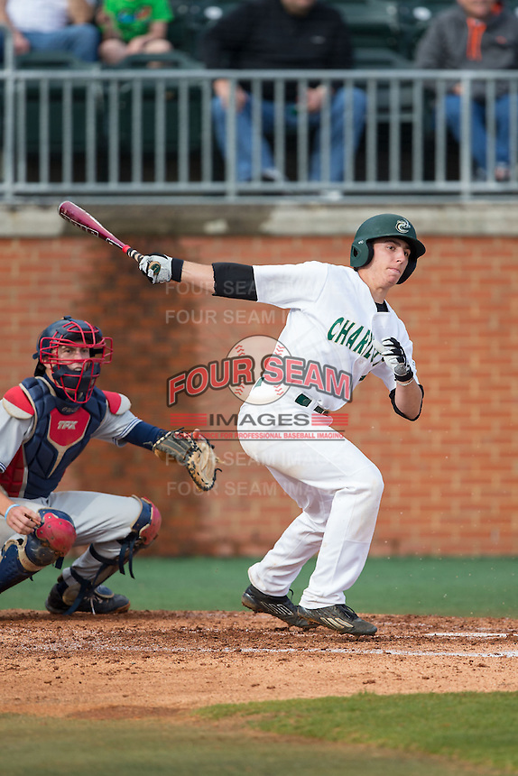 TJ Nichting (1) of the Charlotte 49ers follows through on his swing against the Florida Atlantic Owls at Hayes Stadium on March 14, 2015 in Charlotte, North Carolina.  The Owls defeated the 49ers 8-3 in game one of a double header.  (Brian Westerholt/Four Seam Images)