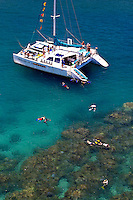 Snorkeling from a catamaran at Honokahau bay is great way to see Maui's colorful marine environment. Maui.