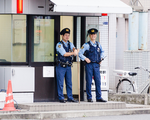 Two police officers near a police box (koban).