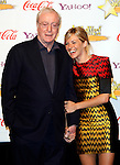 UK actor Sir Michael Caine poses with UK actress Sienna Miller  who receives the Supporting actress of the Year Award at the 2009 ShoWest Awards in Las Vegas, California 2 April 2009. The closing night ceremony for the 2009 ShoWest features top film industry talent at the final night banquet and awards ceremony.