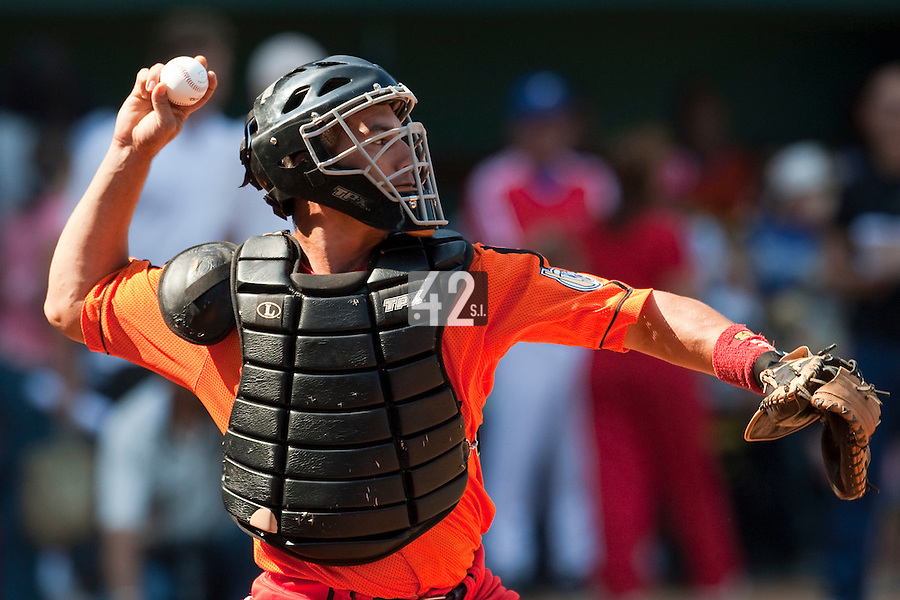 15 February 2009: Catcher Ariel Pestano of the Orientales throws a ball during a training game of Cuba Baseball Team for the World Baseball Classic 2009. The national team is pitted against itself, divided in two teams called the Occidentales and the Orientales. The Orientales win 12-8, at the Latinoamericano stadium, in la Habana, Cuba.
