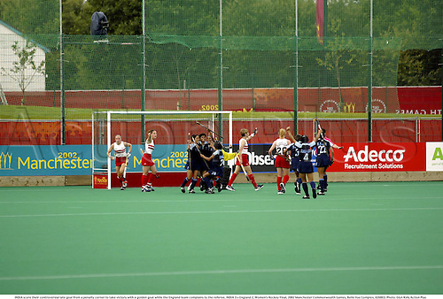 INDIA score their controversial late goal from a penalty corner to take victory with a golden goal while the England team complains to the referee, INDIA 3 v England 2, Women's Hockey Final, 2002 Manchester Commonwealth Games, Belle Vue Complex, 020803. Photo: Glyn Kirk/Action Plus...ball .field.woman.celebrate celebration celebrations joy.despair misery.controversy.female