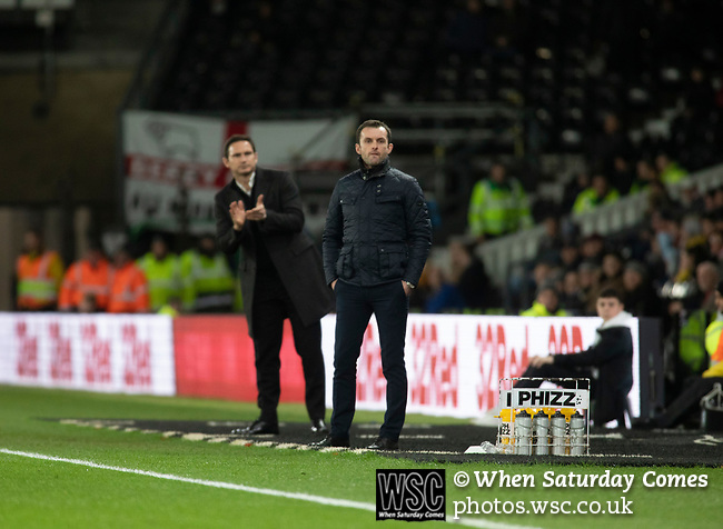 Visiting manager Nathan Jones (right) and his opposite number Frank Lampard watching the first-half action as Derby County played Stoke City in an EFL Championship match at Pride Park Stadium. Opened in 1997, it is the 16th-largest football ground in England and the 20th-largest stadium in the United Kingdom. The fixture ended in a 0-0 draw watched by a crowd of 25,685.