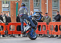 21/02/'11 World Champion Street Bike Freestyle Rider, Mattie Griffin (from Galway) pictured on his BMW F800R this afternoon at Smithfield Square where he demonstrated some of his skills and stunts at the launch of the 'ZUP', the world's first motorcycle clothing connector system. ZUP allows riders to turn their favourite riding gear, leather into a suit by connecting trousers with jacket at the waist. The system was developed by two Irish bikers, Doreen Connaughton and Frank Mullen..Picture Colin Keegan, Collins, Dublin.