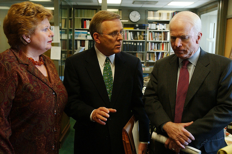 Sens. Debbie Stabenow, D-Mich., Byron Dorgan, D-N.D., and John McCain, R-Ariz., talk before holding a news conference to block the nomination of Mark McClellan to head the HHS Centers for Medicare and Medicaid Services.  .McClellan is against the reimportation of prescription drugs.